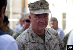 Marine Gen. Frank McKenzie, the head of U.S. Central Command, attends a ceremony where Gen. Scott Miller, not pictured, handed over command, at Resolute Support headquarters, in Kabul, Afghanistan, July 12, 2021.
