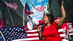 美国通信服务巨头员工罢工示威