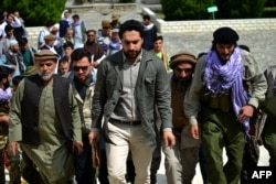 FILE - Ahmad Massoud (C) son of late Afghan commander Ahmad Shah Massoud, arrives to attend and address a gathering at the tomb of his late father in Panjshir province on July 5, 2021.