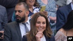 FILE - Britain's Kate, Duchess of Cambridge sits in the Royal Box on Centre Court on day five of the Wimbledon Tennis Championships in London. The Duchess of Cambridge is now self-isolating after a contact tested positive for the coronavirus.