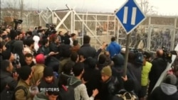 Macedonian Police Tear Gas Migrants