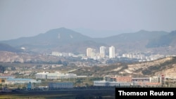 FILE PHOTO: Kaesong city is seen behind the inter-Korean Kaesong Industrial Complex, across the DMZ separating North Korea from South Korea in this picture taken from Dora observatory in Paju