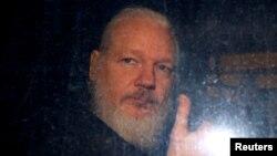 FILE - WikiLeaks founder Julian Assange is seen as he leaves a police station in London, Britain, April 11, 2019.