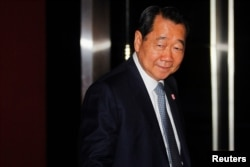 FILE - Dhanin Chearavanont, chairman of Thailand's largest agribusiness group, Charoen Pokphand Food, arrives at a Thailand-China Business Council Seminar in Bangkok, March 15, 2013.