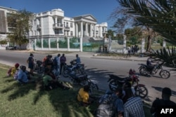Journalists gather outside the Supreme Court of Haiti (Cours de cassation)on, Feb. 8, 2021 in the almost empty streets of Port-au-Prince.