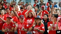 FILE - Culinary Union members cheer as they rally in support of Democratic candidates at the culinary union hall in Las Vegas, Nov. 5, 2018.