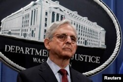 FILE - U.S. Attorney General Merrick Garland attends a news conference at the Department of Justice in Washington, June 25, 2021.
