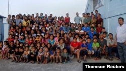 Family members of Ziona poses for group photograph outside their residence in village Baktawng, June 14, 2021.