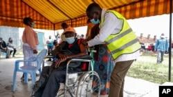 A Kenyan man receives a dose of the AstraZeneca coronavirus vaccine donated by Britain, at the Makongeni Estate in Nairobi, Kenya, Aug. 14, 2021.