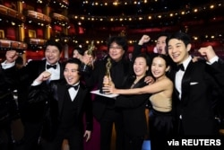 """Bong Joon Ho and the cast of """"Parasite"""" pose at the 92nd Academy Awards in Hollywood, Los Angeles, California, Feb. 9, 2020."""