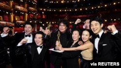"Bong Joon Ho and the cast of ""Parasite"" pose at the 92nd Academy Awards in Hollywood, Los Angeles, California, Feb. 9, 2020."