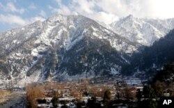 Snow covers areas of Kundalshahi, in Neelum Valley, Pakistan-administered Kashmir, Jan. 14, 2020.