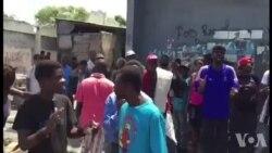 Manifestasyon nan Lasalin pou Komemore 30 Lane Masak Legliz Sen Janbosko a