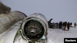 The wreckage of an airplane is seen after a crash in Deh Yak district of Ghazni province, Afghanistan January 27, 2020. NO RESALES. NO ARCHIVES.