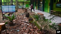 Pieces of roof tiles and other debris litter the ground at a school following an earthquake in Malang, East Java, Indonesia, Saturday, April 10, 2021. A strong earthquake damaged buildings on Indonesia's main island of Java and shook the tourist…