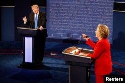 FILE - Republican presidential nominee Donald Trump and Democratic presidential nominee Hillary Clinton speak simultaneously during their first presidential debate at Hofstra University in Hempstead, New York, Sept. 26, 2016.