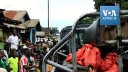La police récupère le corps après un lynchage à Beni