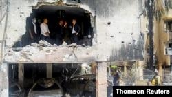 مقامات اسرائيل وزير خارجه آلمان را به بازدید از یک ساختمان آسیب دیده در حملات راکتی از غزه بردند -۳۰ اردیبهشت ۱۴۰۰