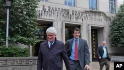 FILE - Greg Craig, former White House counsel to former President Barack Obama, left, leaves federal court in Washington, April 12, 2019.