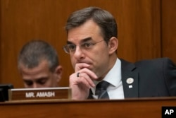 FILE - Rep. Justin Amash listens during a House committee hearing on Capitol Hill in Washington, June 12, 2019.