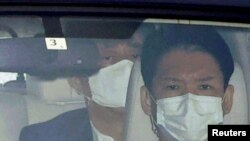 Japanese Prime Minister Shinzo Abe arrives by a car at Keio University Hospital, amid speculation about his health, in Tokyo, Japan, in this photo taken by Kyodo, August 24, 2020.