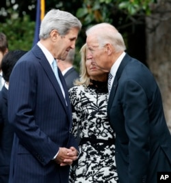 FILE - Secretary of State John Kerry, left, talks with Vice President Joe Biden on Sept. 25, 2015, on the South Lawn of the White House in Washington.