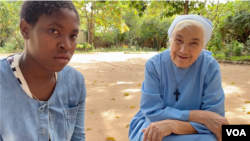Sifa Maulana, 14, and Mother Maria speak with a reporter outside the Mater Dei Monastery in Nampula, northern Mozambique, May 30, 2021.