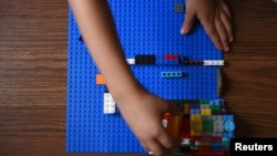 Sawyer Roellchen, 5, plays with Legos in his family's new home at Lackland Air Force Base in San Antonio, Texas, Nov. 16, 2019.