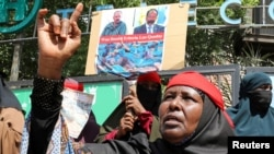 A woman reacts during a protest of Somali women who say their sons have been used as fighters in the Tigray conflict in neighboring Ethiopia, in Mogadishu, Somalia, June 10, 2021.
