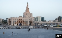 FILE - The Souq Waqif tourist bazaar is almost deserted in an effort to stop the spread of COVID-19, in Doha, Qatar, March 16, 2020.