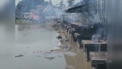 Nepal Cremates Victims, Coordinates Aid
