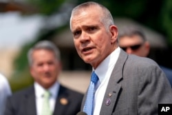FILE - Rep. Matt Rosendale, R-Mont., speaks at a news conference held by members of the House Freedom Caucus on Capitol Hill in Washington, July 29, 2021.