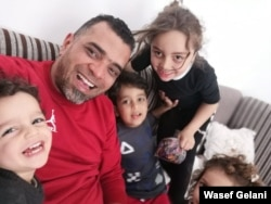 Wasef Gelani and his four children fled their home a year ago, and now they remain in a rented apartment hearing bombings everyday, March 23, 2020.