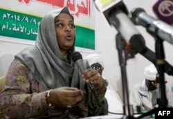 FILE - Mariam al-Mahdi, then-Sudanese deputy leader of the Umma Party, speaks during a press conference in the capital Khartoum, September 9, 2014.