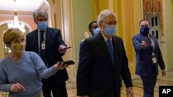 FILE - Senate Republican Majority Leader Mitch McConnell walks past reporters on Capitol Hill in Washington, Dec. 15, 2020.