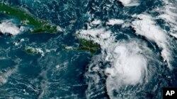 Foto satelit ketika badai tropis Fred melewati Puerto Rico dan Republik Dominika hari Rabu pagi (11/8).