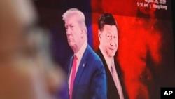 南韓首爾電腦屏幕上顯示的美國總統特朗普與中國國家主席習近平的圖像。
