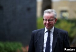 FILE - Britain's Chancellor of the Duchy of Lancaster Michael Gove arrives for a Cabinet meeting, in London, Oct. 13, 2020.