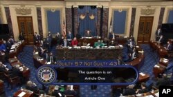 In this image from video, the final vote total of 57-43, to acquit former President Donald Trump of the impeachment charge, incitement of insurrection, in the Senate at the U.S. Capitol in Washington, Saturday, Feb. 13, 2021. (Senate Television via…