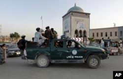 Taliban fighters patrol inside the city of Kandahar, southwest Afghanistan, Aug. 15, 2021.