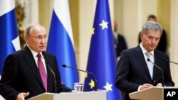 Russian President Vladimir Putin (L) and Finland's President Sauli Niinisto are seen at their joint press conference in the Presidential Palace in Helsinki, Finland, Aug. 21, 2019. Putin is on an official visit to Finland.