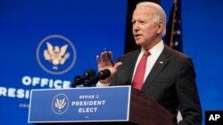 President-elect Joe Biden, accompanied by Vice President-elect Kamala Harris, speaks at The Queen theater, Nov. 19, 2020, in Wilmington, Del.