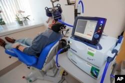 FILE - A patient receives a transcranial magnetic stimulation treatment at the VA Palo Alto Health Care System, Palo Alto, California, Nov. 7, 2018.