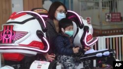 Visitors wear face masks to protect against the spread of the new coronavirus at Taipei Children's Amusement Park in Taipei, Taiwan, Saturday, April 11, 2020. The new coronavirus causes mild or moderate symptoms for most people, but for some,…