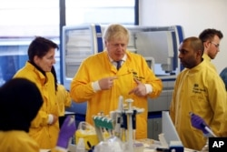 Britain's Prime Minister Boris Johnson visits a laboratory at the Public Health England National Infection Service, after more than 10 new coronavirus patients were identified in England, in Colindale, north London, March 1, 2020.