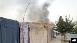 FILE - Smoke rises from the city of Lashkar Gah after airstrikes against Taliban in Helmand province southern of Kabul, Afghanistan, Aug. 6, 2021.