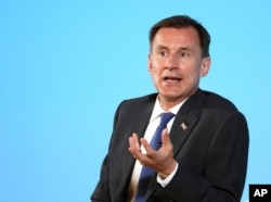 Conservative party leadership contender Jeremy Hunt speaks during a party leadership gathering in Belfast, Northern Ireland, July 2, 2019.