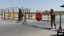 Uzbek soldiers guard a checkpoint near Friendship Bridge over the Amu Darya River, which separates Uzbekistan and Afghanistan, Termez, Uzbekistan, Aug. 15, 2021.