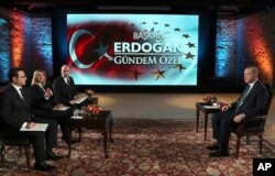 Turkey's President Recep Tayyip Erdogan, right, speaks during an interview with private A Haber and ATV television channels, in Istanbul, Dec. 15, 2019.