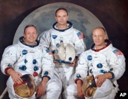 """FILE - This March 30, 1969, photo made available by NASA shows the crew of the Apollo 11, from left, Neil Armstrong, commander; Michael Collins, module pilot; Edwin E. """"Buzz"""" Aldrin, lunar module pilot."""